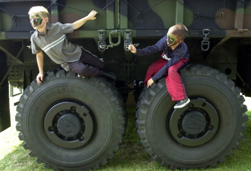 boys-playing-marine-truckjpg-d1a7eafe53fd0ba7